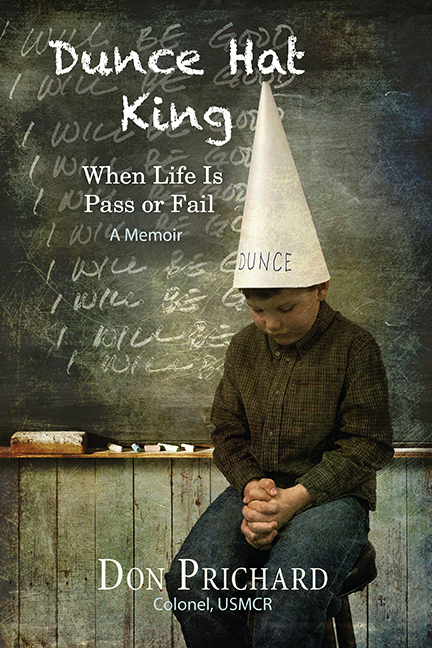 Cover of Dunce Hat King by Don Prichard shows child sitting in front of class wearing a dunce hat