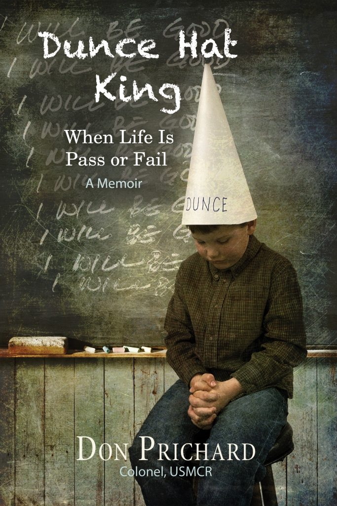 Cover of Dunce Hat King by Don Prichard shows child sitting at front of class wearing dunce hat
